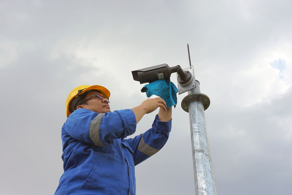 stock-photo-a-male-worker-doing-a-maintenance-work-by-cleaning-and-inspecting-security-camera-544352701.jpg