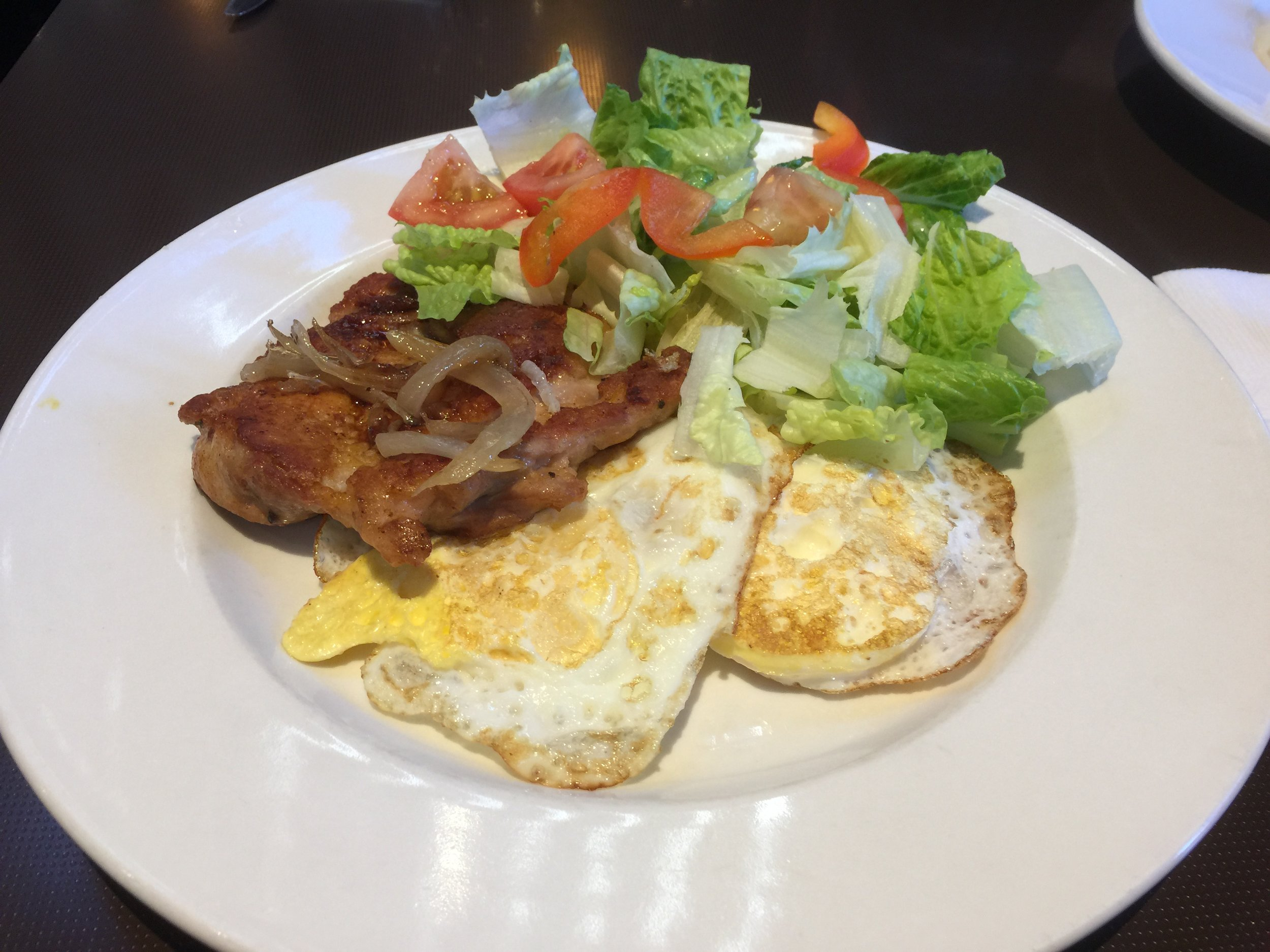 Chicken Steak, two eggs, salad is extra $2.50 add on. Without the salad it's $7.95 and comes with a hot drink.