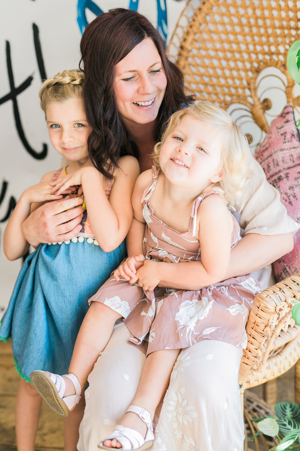 This is Meagan Vos, the face behind the stunning floral design at   MV Florals  .  Niki actually introduced us and she's been our lead florist at Forrest and J from the begining! We admire Meagan's kind heart and sweet energy.  She's the most encouraging WoMom we know. Pictured with Sadie and Summer.