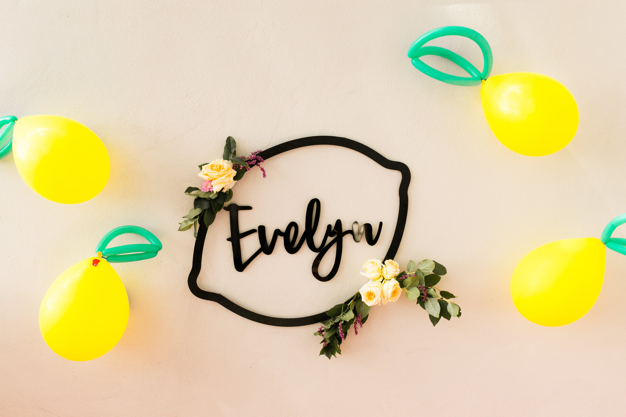Lemonade Birthday Party - Acrylic Name Sign by Midnight Confetti with Lemon Balloons