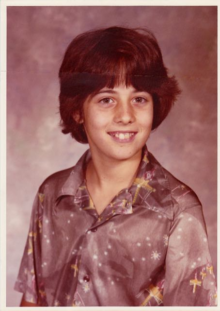 "Me in sixth grade, wearing my favorite shirt. It was 100 percent genuine polyester and adorned with fake X-wing fighters. For some reason, I was not voted ""best dressed"" that year. Or in any year thereafter."