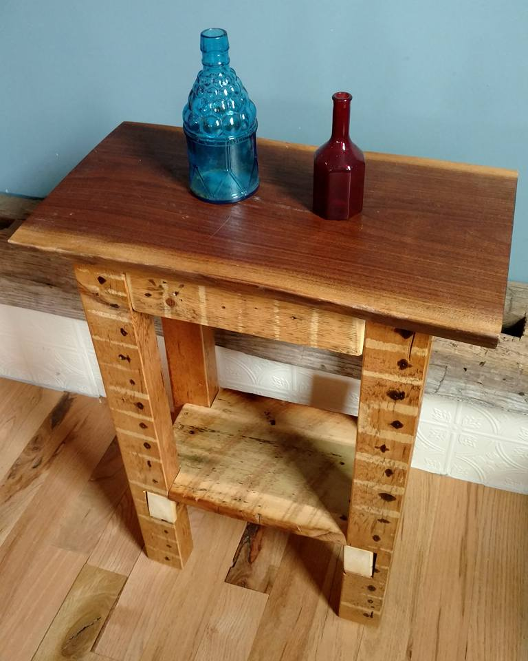 Side table with slab top and reclaimed wood legs