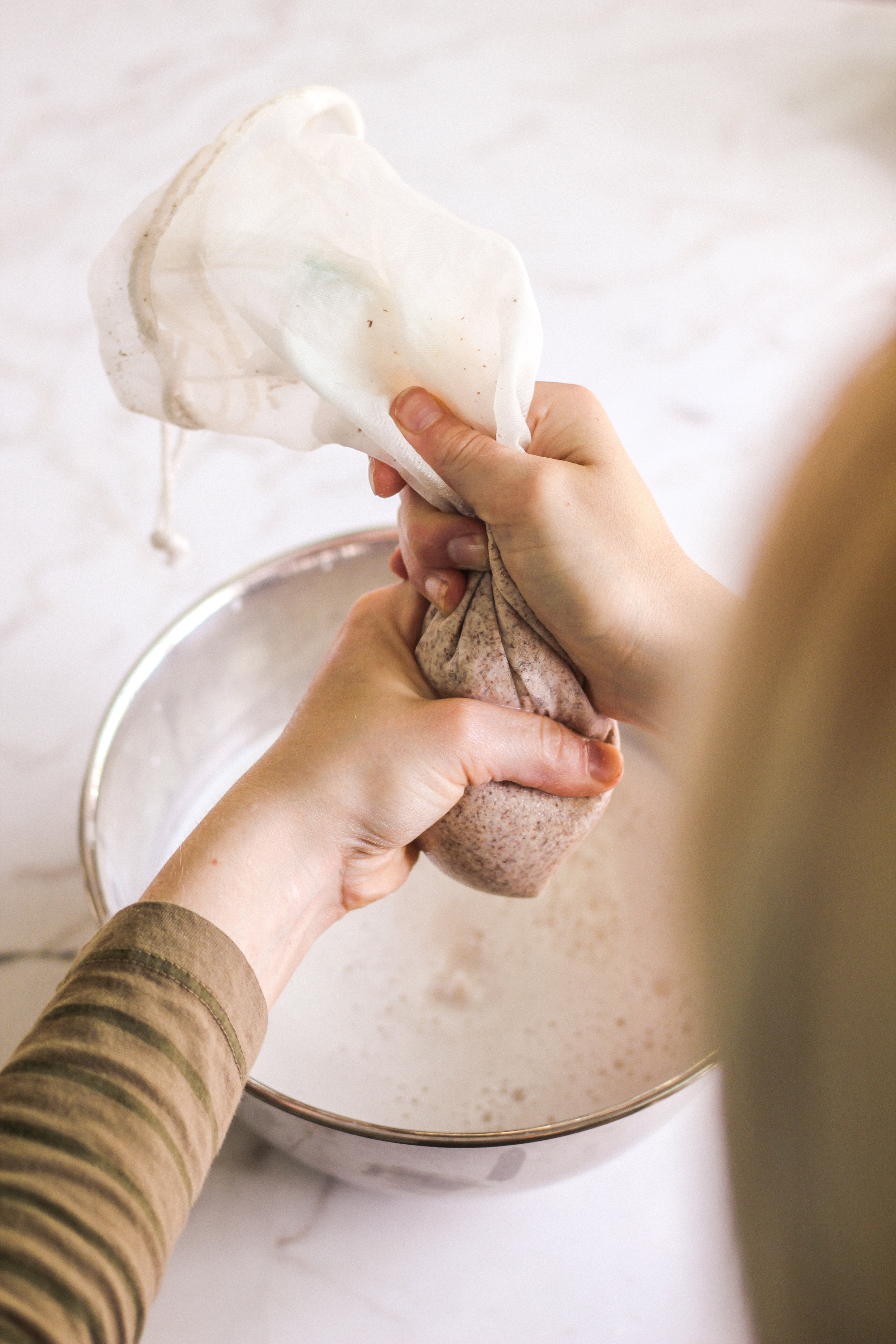Squeeze your nut milk bag until no more liquid comes out, of course, making sure your hands are clean for this step.