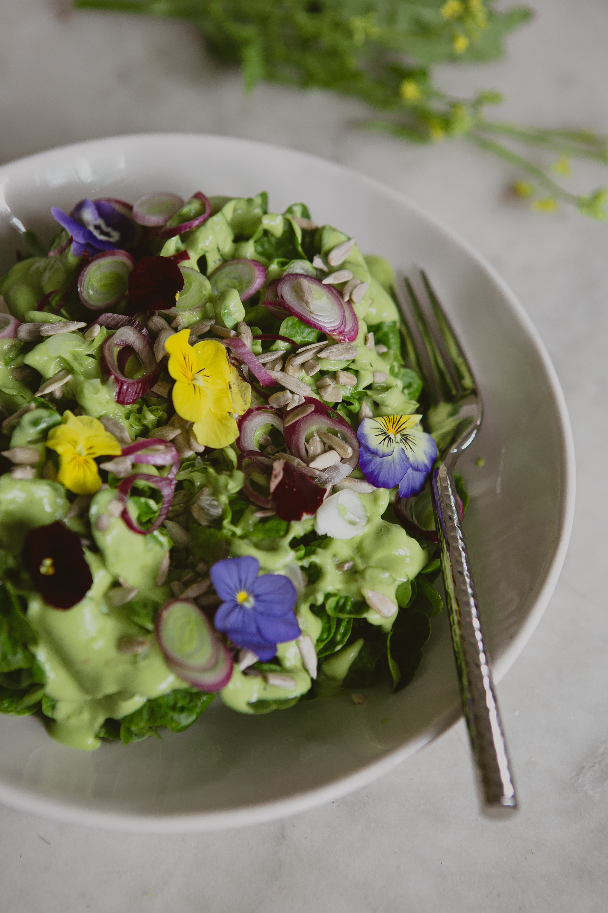 Seamus Mullen's beautiful little gem salad with Green Goddess Dressing, shallot and sprouted sunflower seeds.