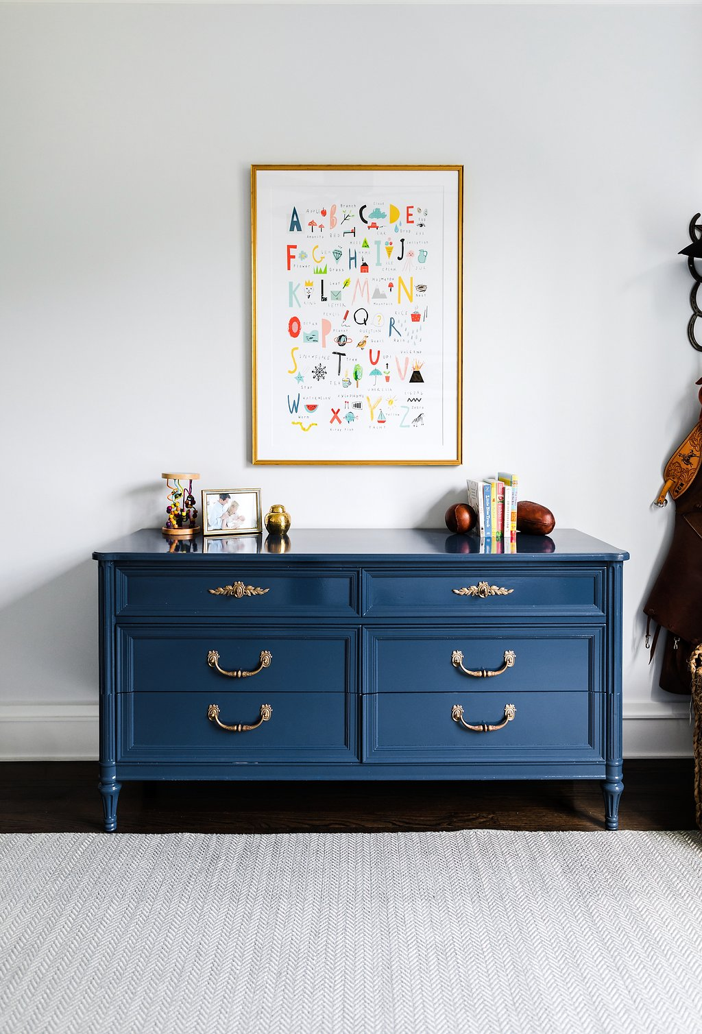 Shown above is a custom painted vintage dresser sourced at the CEH for Katie's client, Work of Katie Davis Design