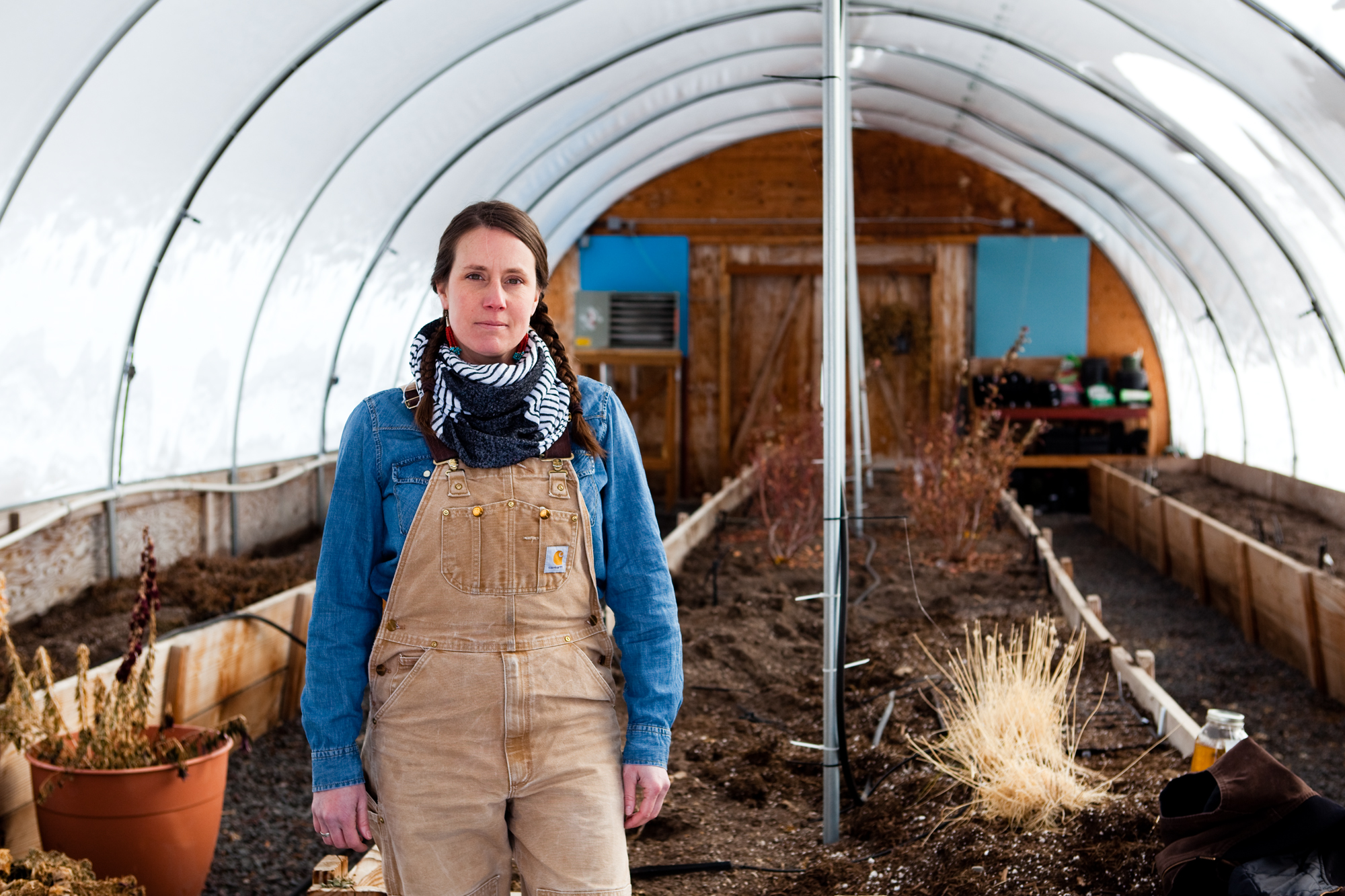 Spring Olson, 41, in a greenhouse at Bendistillery