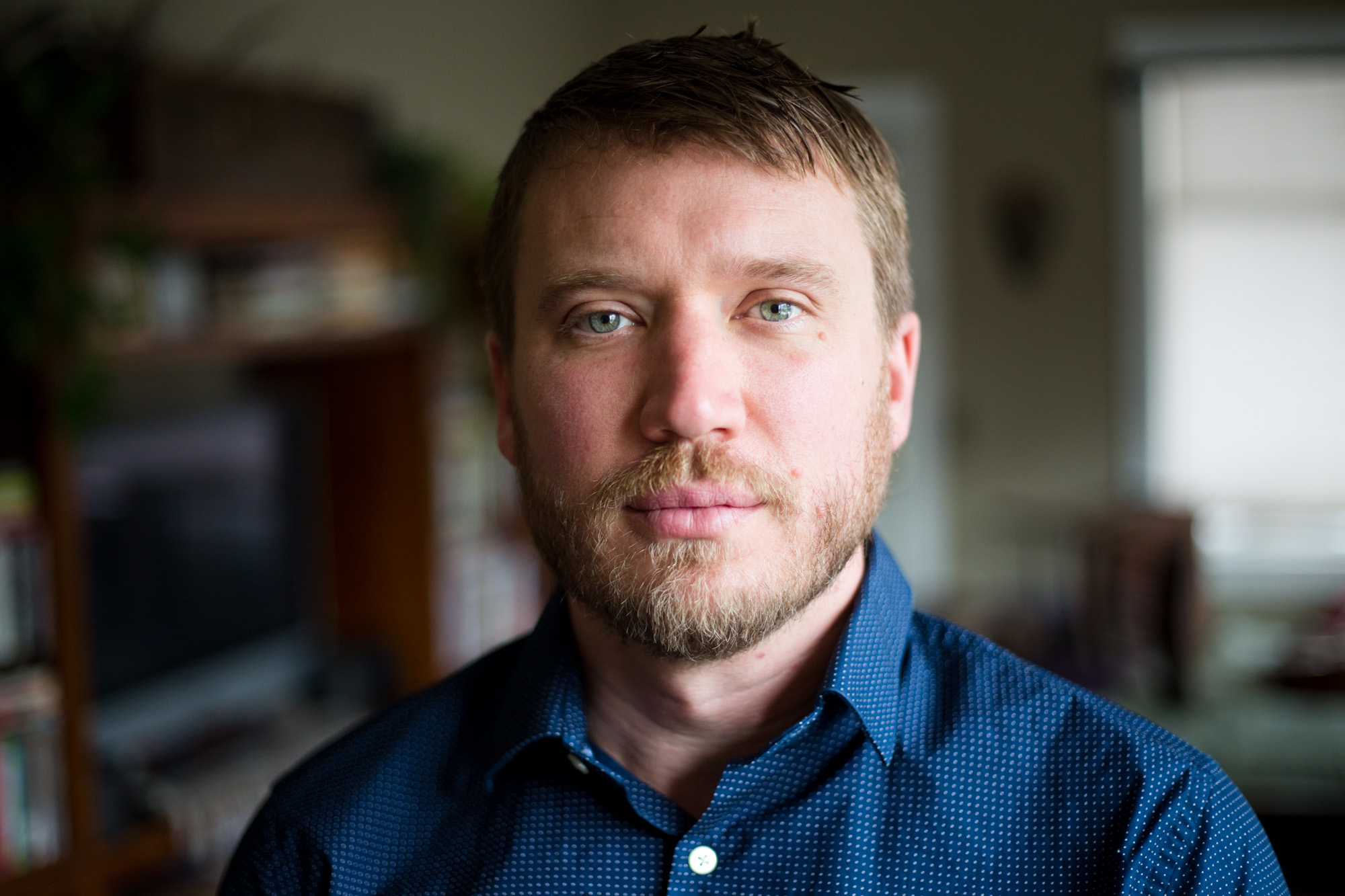 Russell Huntamer, 39, at his home