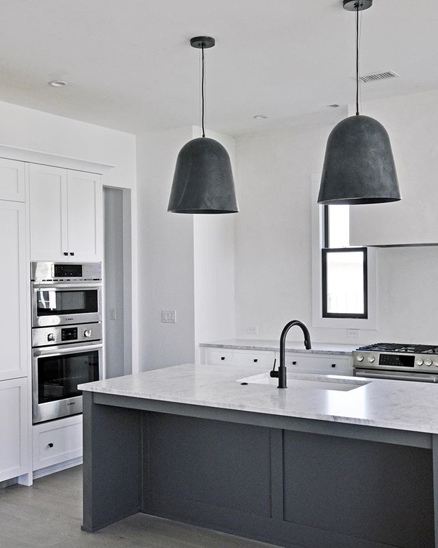 These oversized @visualcomfortco lights make this kitchen // Our proprietary software makes our design process and budgeting predictable so that we can make impactful design decisions in the spaces that matter most.