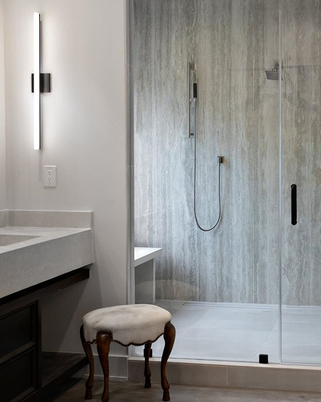 Talk about turning your master bath into a spa. This shower is 7'x9', encased in massive slabs of porcelain tile (grout lines who??), and has more shower heads and rain heads than you can imagine. We custom fabricated a concrete bench to make the perfect sitch for shaving your legs, or whatever you like to do in your shower. 😉