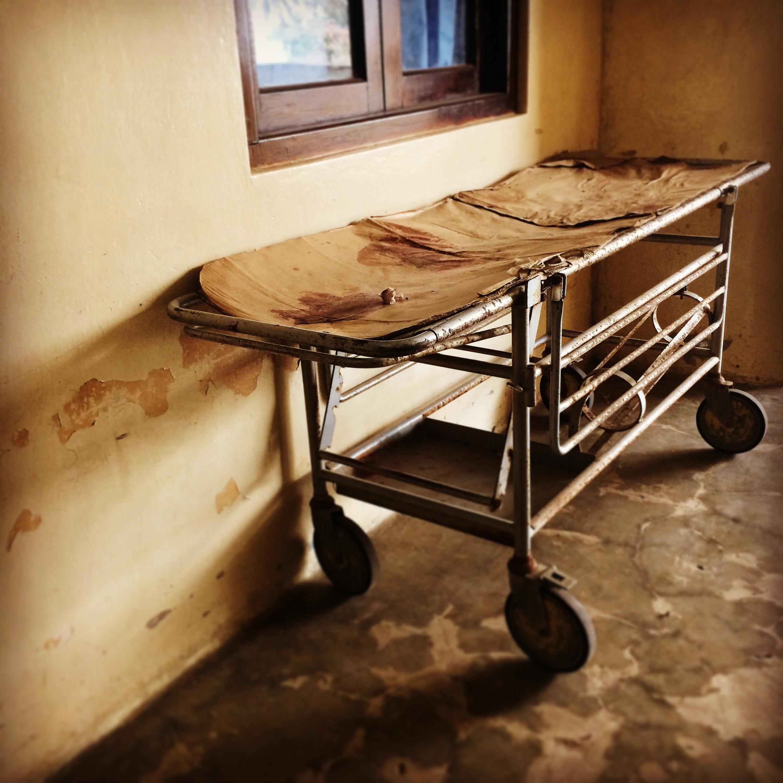 Blood on gurney left unattended in hallway of public hospital  Mnazi Mmoja, Tanzania