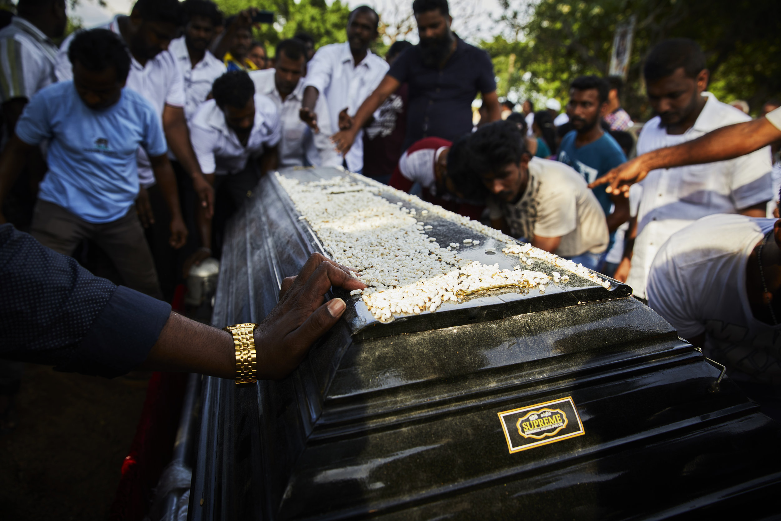 Family and Friends carry the casket of deceased,Loganathan Ramesh, 31 yrs old, who died on April 21,2019 in the St.Anthony's Bomb explosion on easter Sunday. They will take the casket to his local church for blessings and then on to the cemetary for burial.