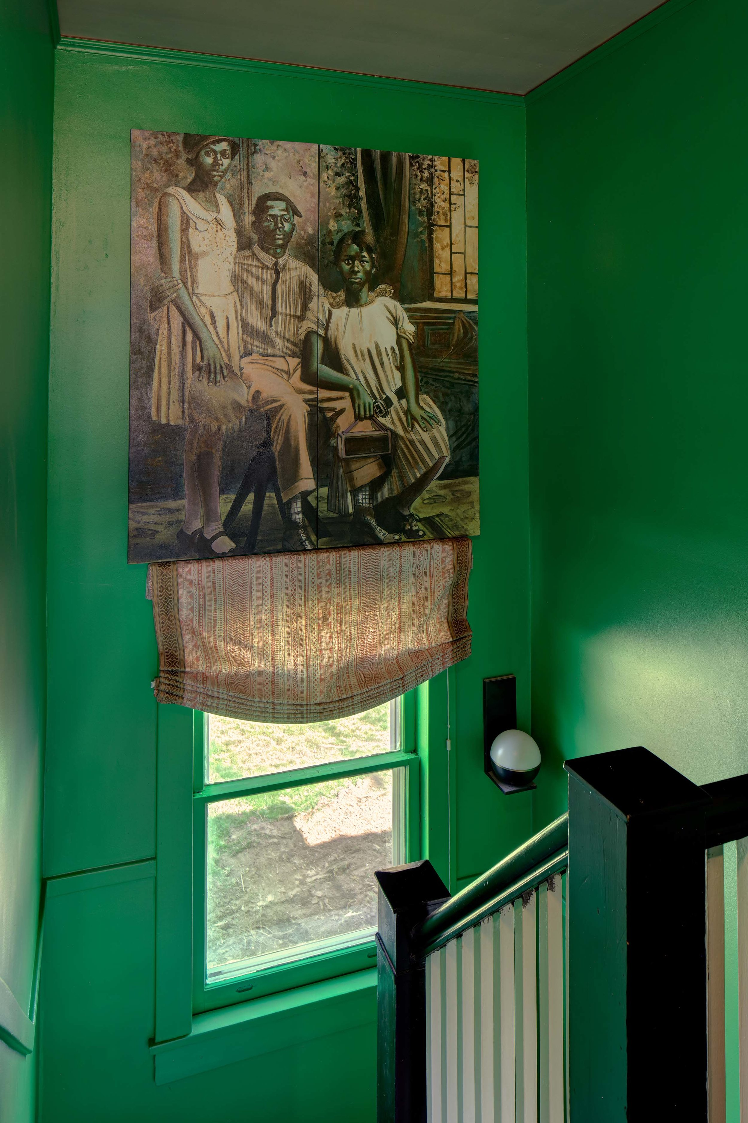 Family in Green Stairwell low res.jpg