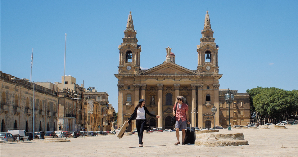 """PHOTO : Carmen and Giovanni explore Malta's rich history and culture behind neoclassical architecture.  (L to R) Marysia S. Peres and Myko Olivier star in """" LOVE TO PARADISE """". Photo: Courtesy of Galea Pictures.© 2017 Galea Pictures. All Rights Reserved."""