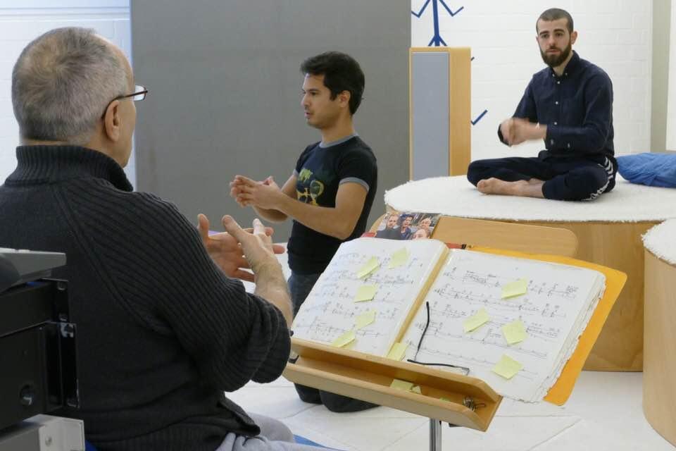 Gisela Alain teaching Diego and Jamil.jpg