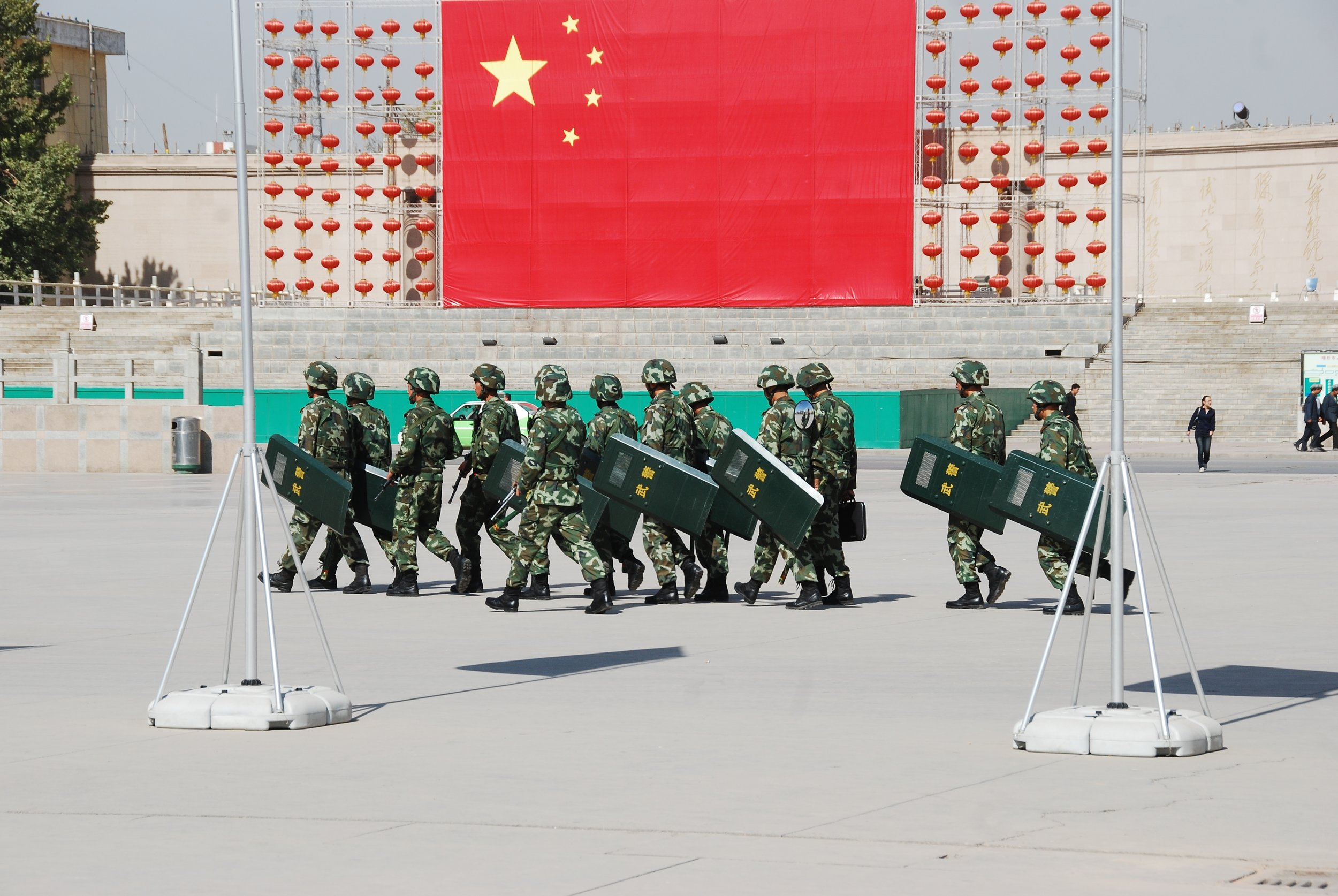 Police Tactical Unit officers on the march in Kashgar's city square.  Antoine 49 /Flickr.