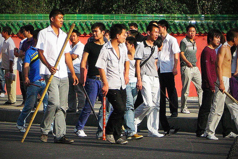 Ethnic Han Chinese patrol the streets with bamboo sticks and batons during the 2009 July Urumqi riots. Photo:  David Vilder .