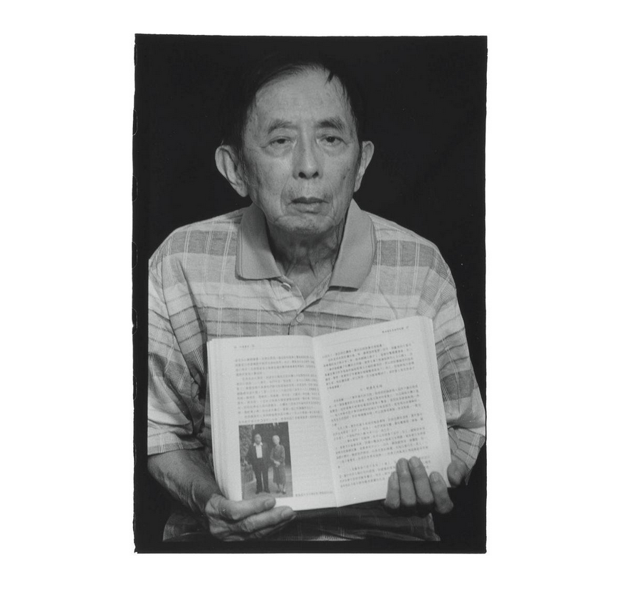 Lu Fang-te holds a book that features his father, Teng Chin-i. Photo courtesy of Pan Hsiao-hsia, from the book  Testimonies of 228  (見證228).