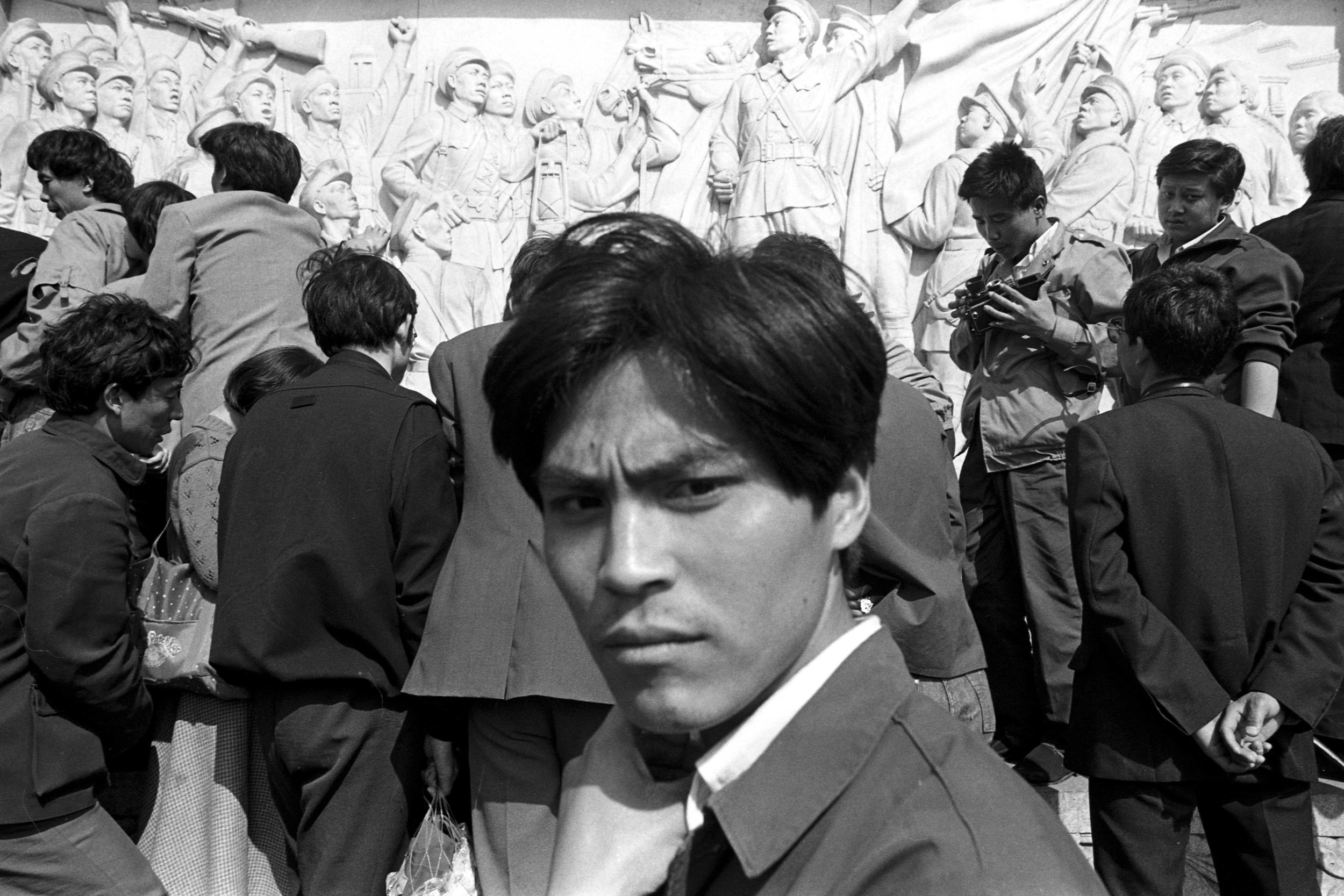 Staring at the camera, with sculptural reliefs from the Monument to the People's Heroes in the background. Photo taken on April 25, 1989. Photo credit: Hsieh San-tai, Howling 1989.