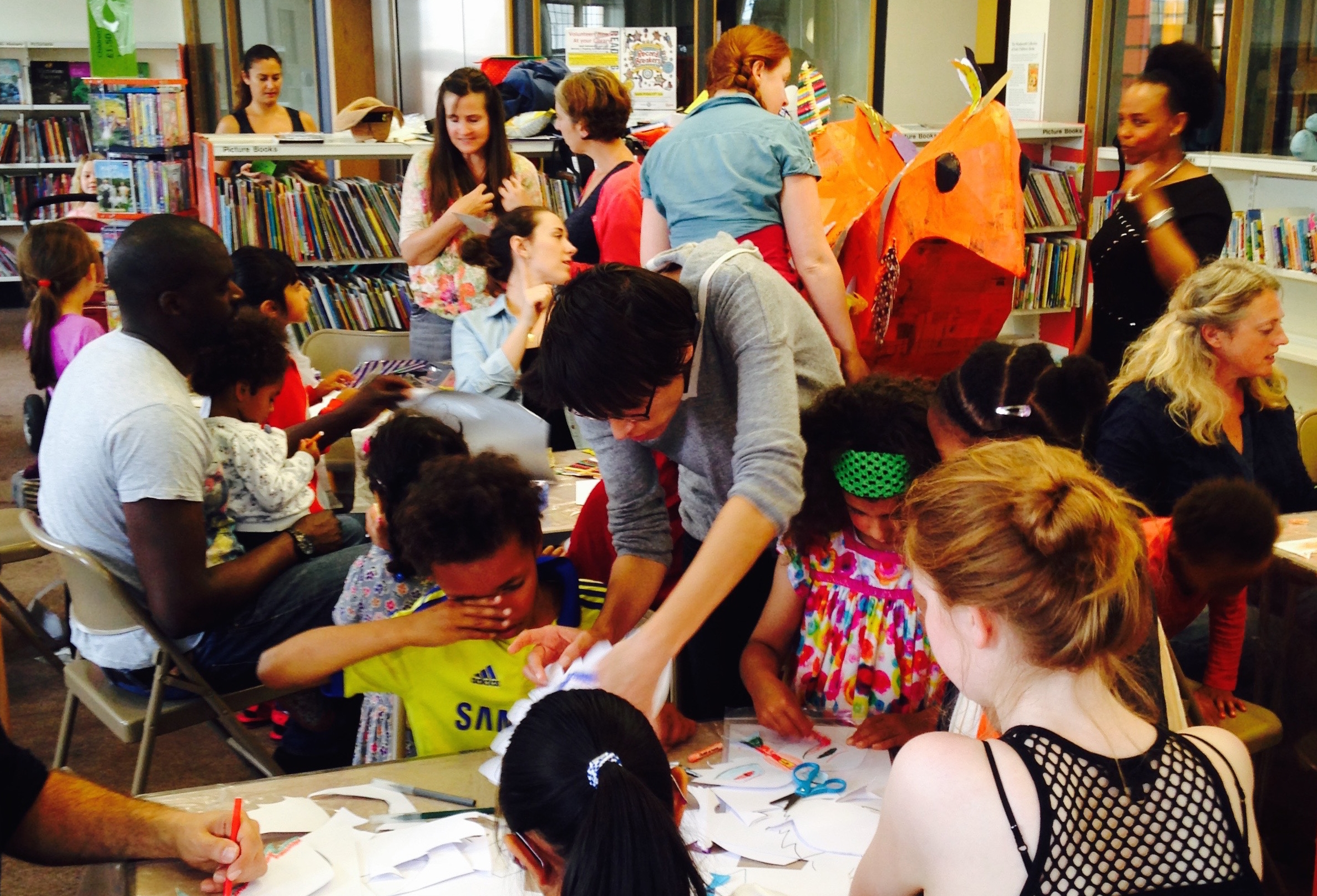 Making puppets and decorating the giant orange bird in Tooting library.
