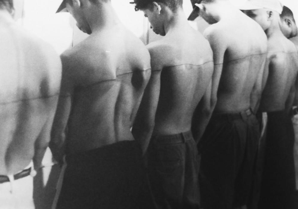 250 cm Line Tattooed on Six People  by Santiago Sierra