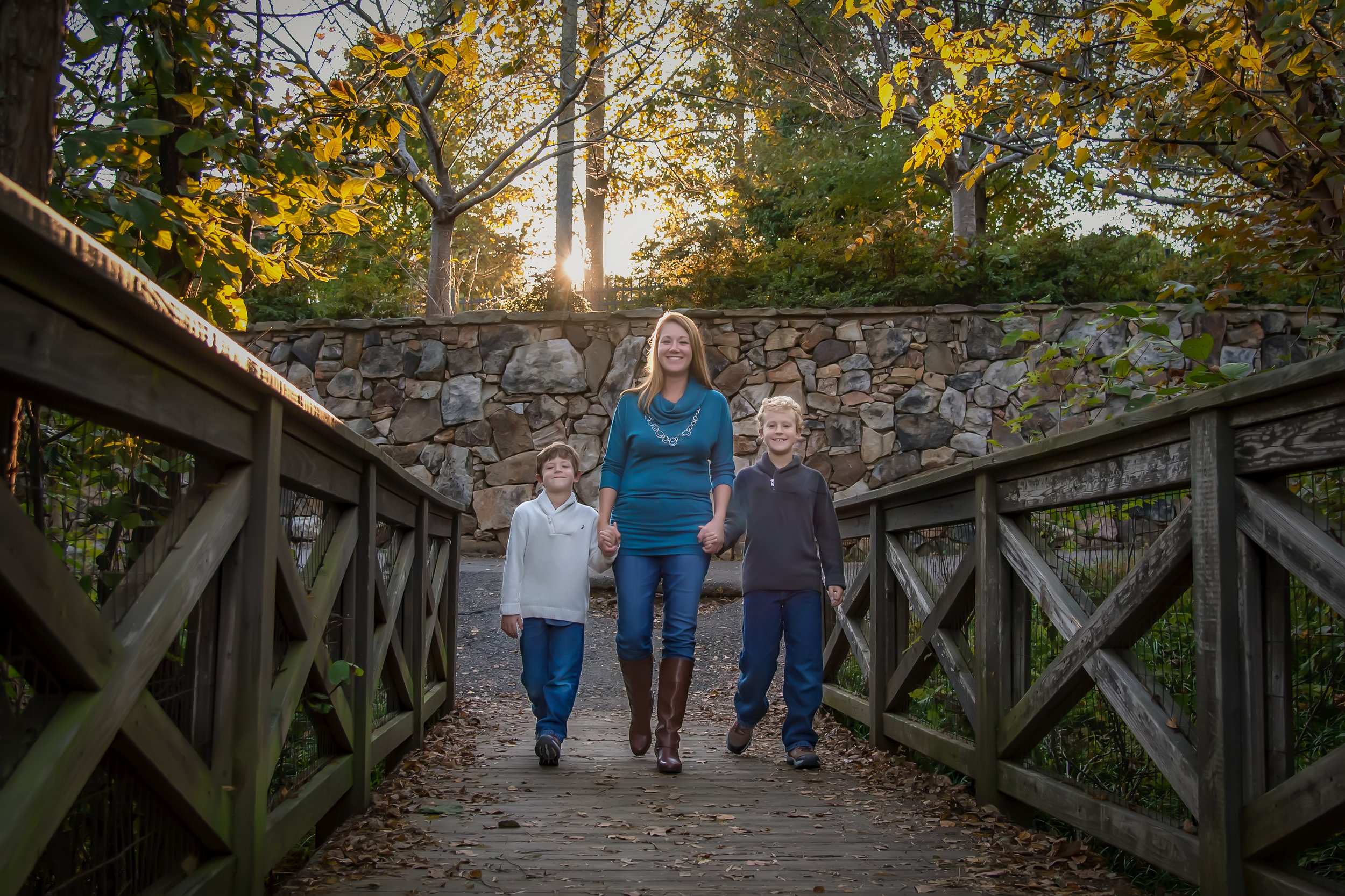 Family of three on bridge fall family portrait