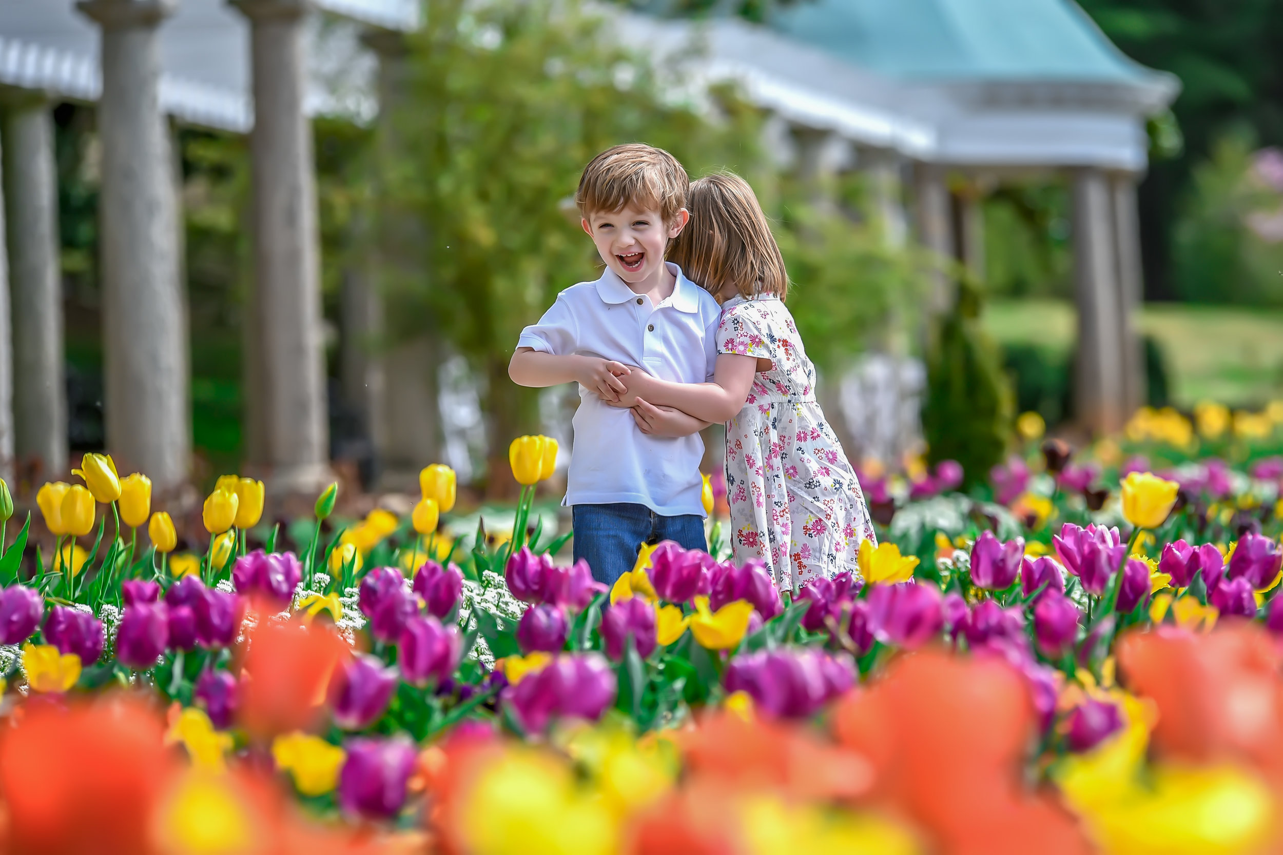 boy girl brother sister twins at spring in tulip garden at maymont in Richmond Virginia