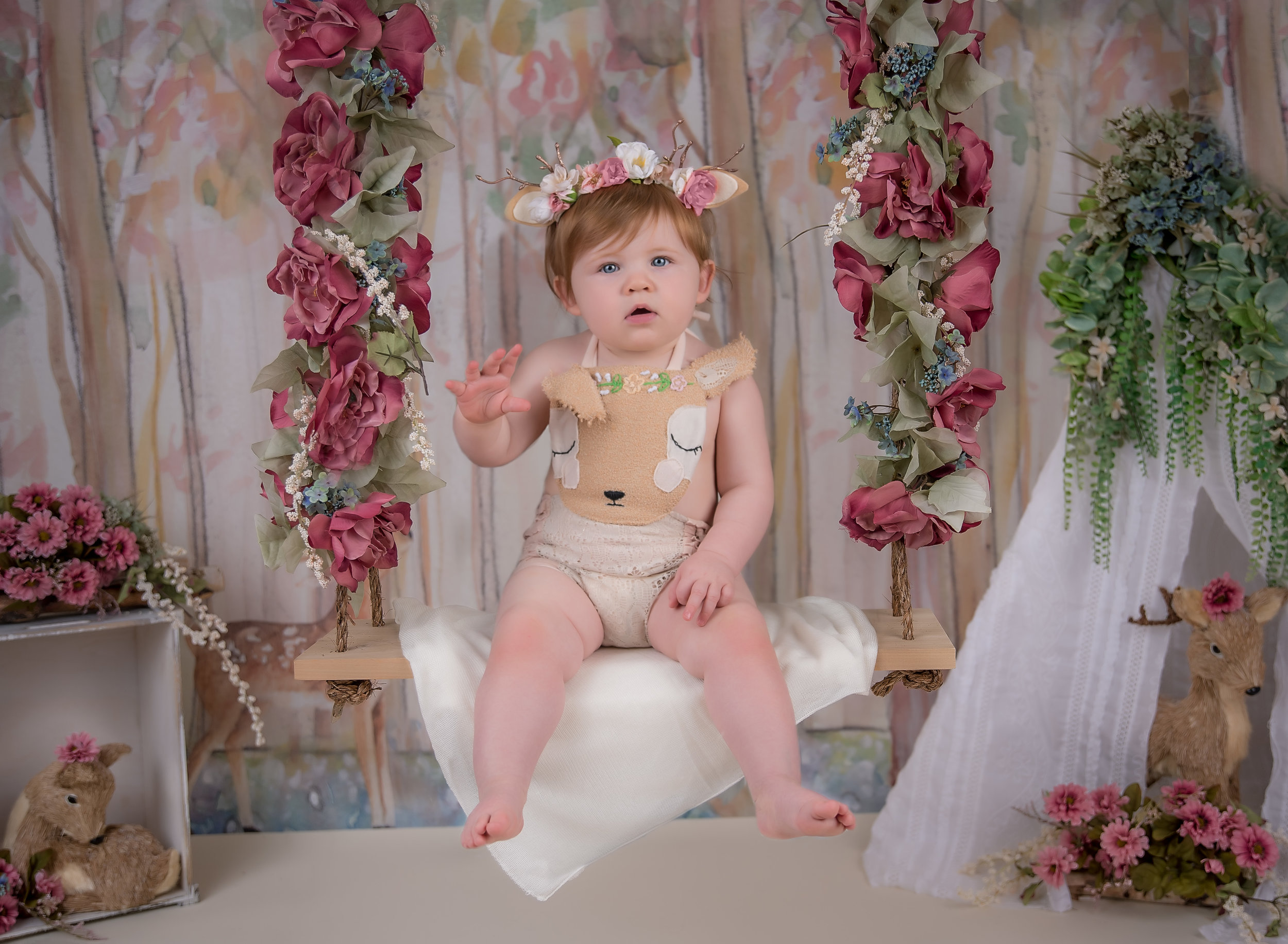 Little girl Fawn baby deer on floral swing woodland theme