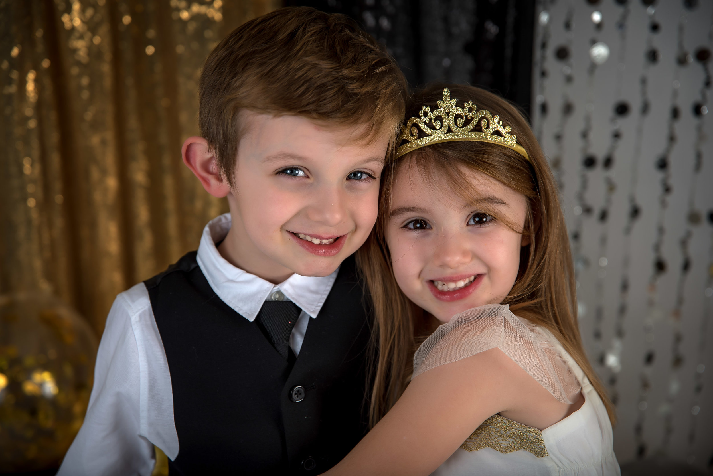 boy and girl siblings sister brother new years mini session black white and gold