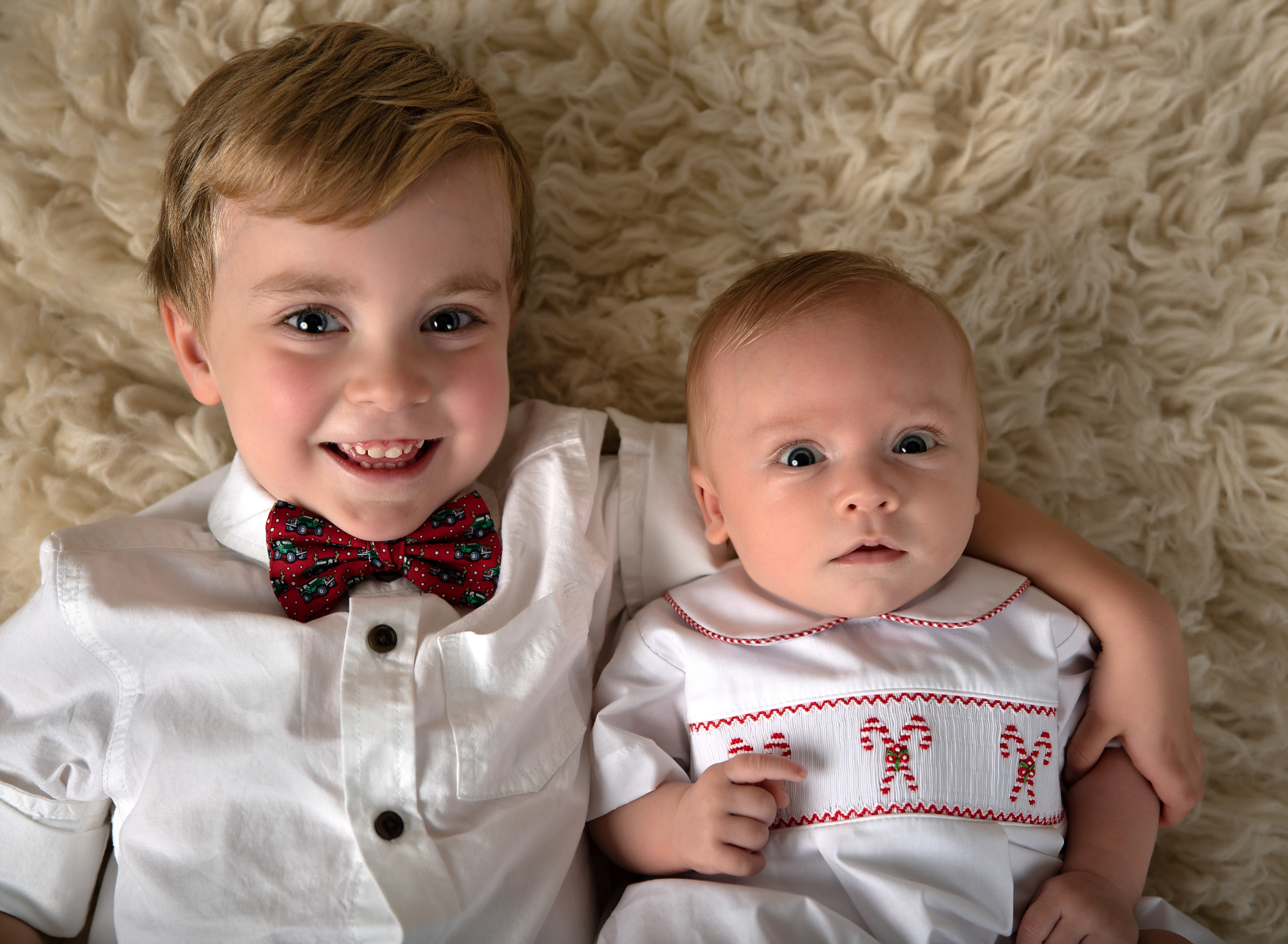 young brothers christmas in studio portrait infant