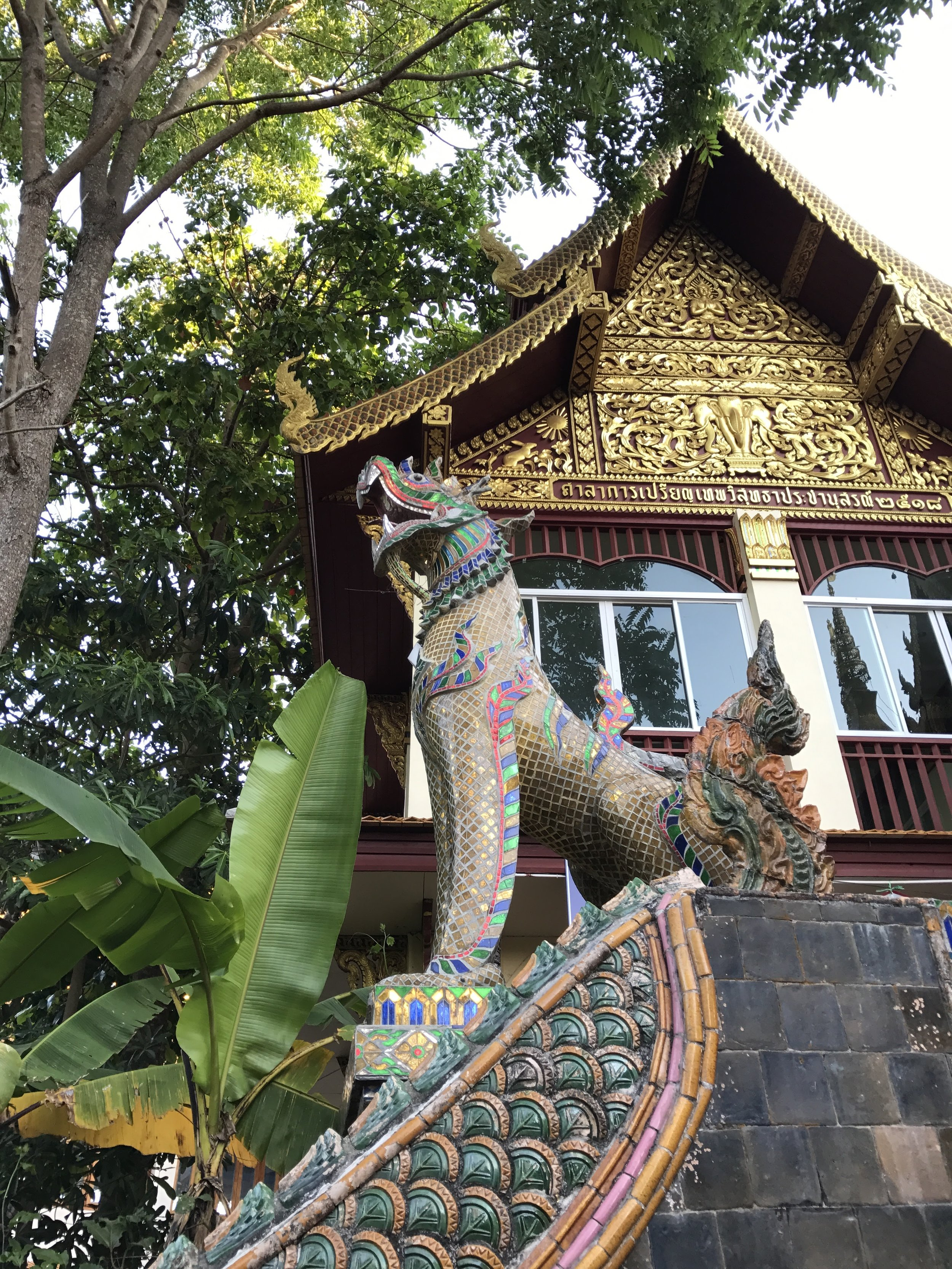Dragons flank both sides of the top of the staircase. There's so much to see at Doi Suthep, we almost missed them!
