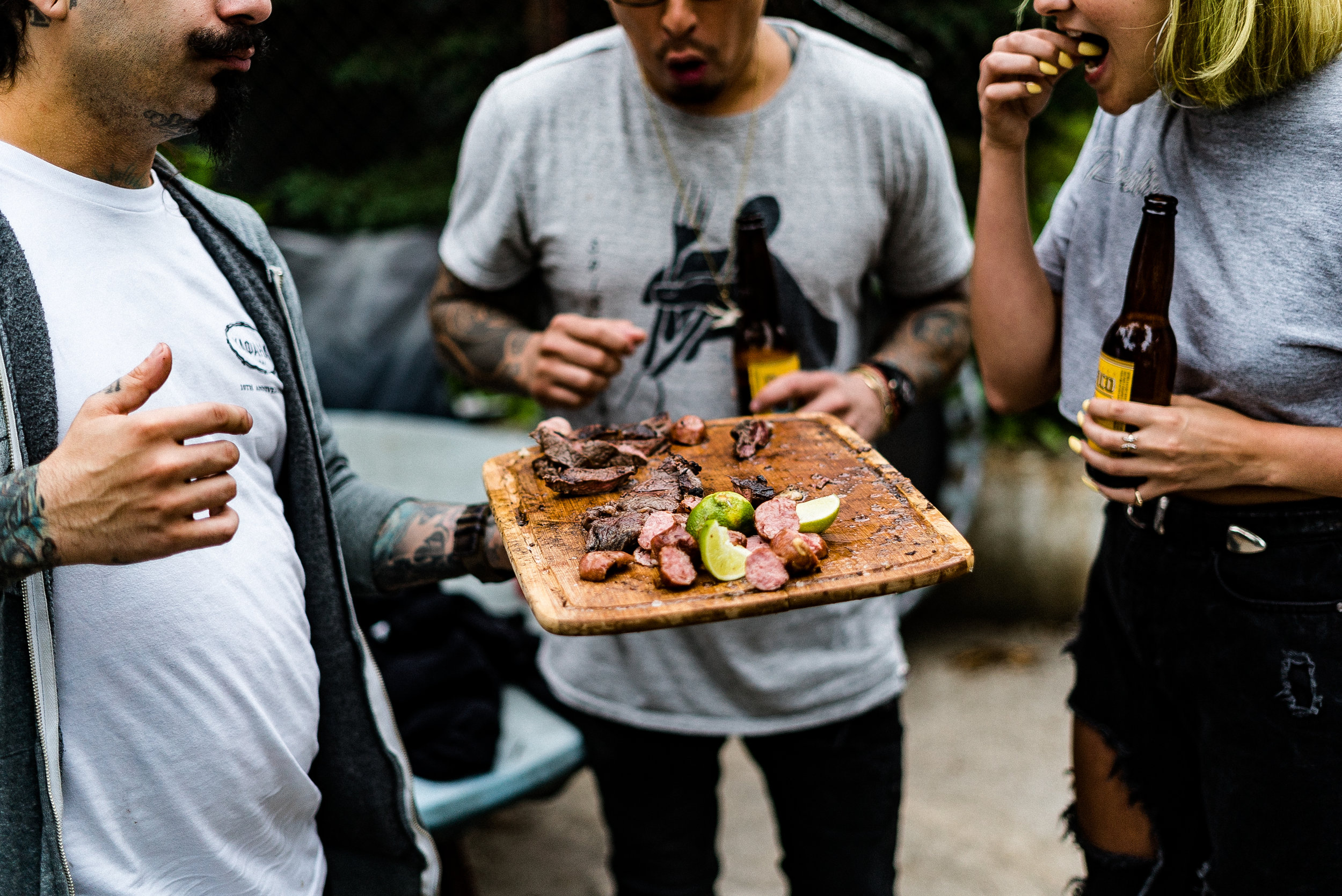 Brazilian chef, serves up steak to party guests.
