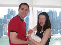 Lisa provides labor support for Becky & Steve (seen here with their baby girl)