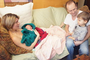 Lisa provides labor support for Virginie & Phillip (seen here with their newborn)