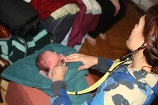 Our midwife checks the baby's vital signs, moments after homebirth in Queens (BirthMattersNYC blog)