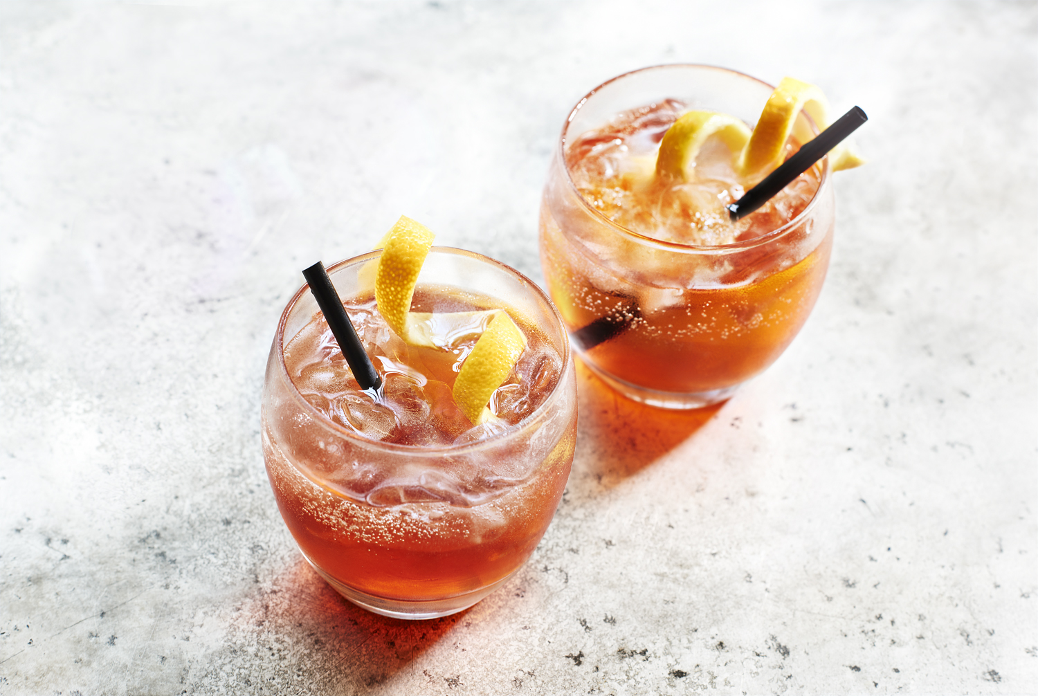"""Food Hall's cocktail recipe using campari, gin and prosecco for a Negroni Sbagliato. A translation literally meaning """"wrong negroni"""", so-called as the first one was made by a bartender in error when he reached for prosecco instead of gin when making a negroni. A Negroni Sbagliato traditionally leaves out the gin but we have thrown it in alongside for good measure. We end up with a less hardcore version of a negroni but a longer and more refreshing version."""