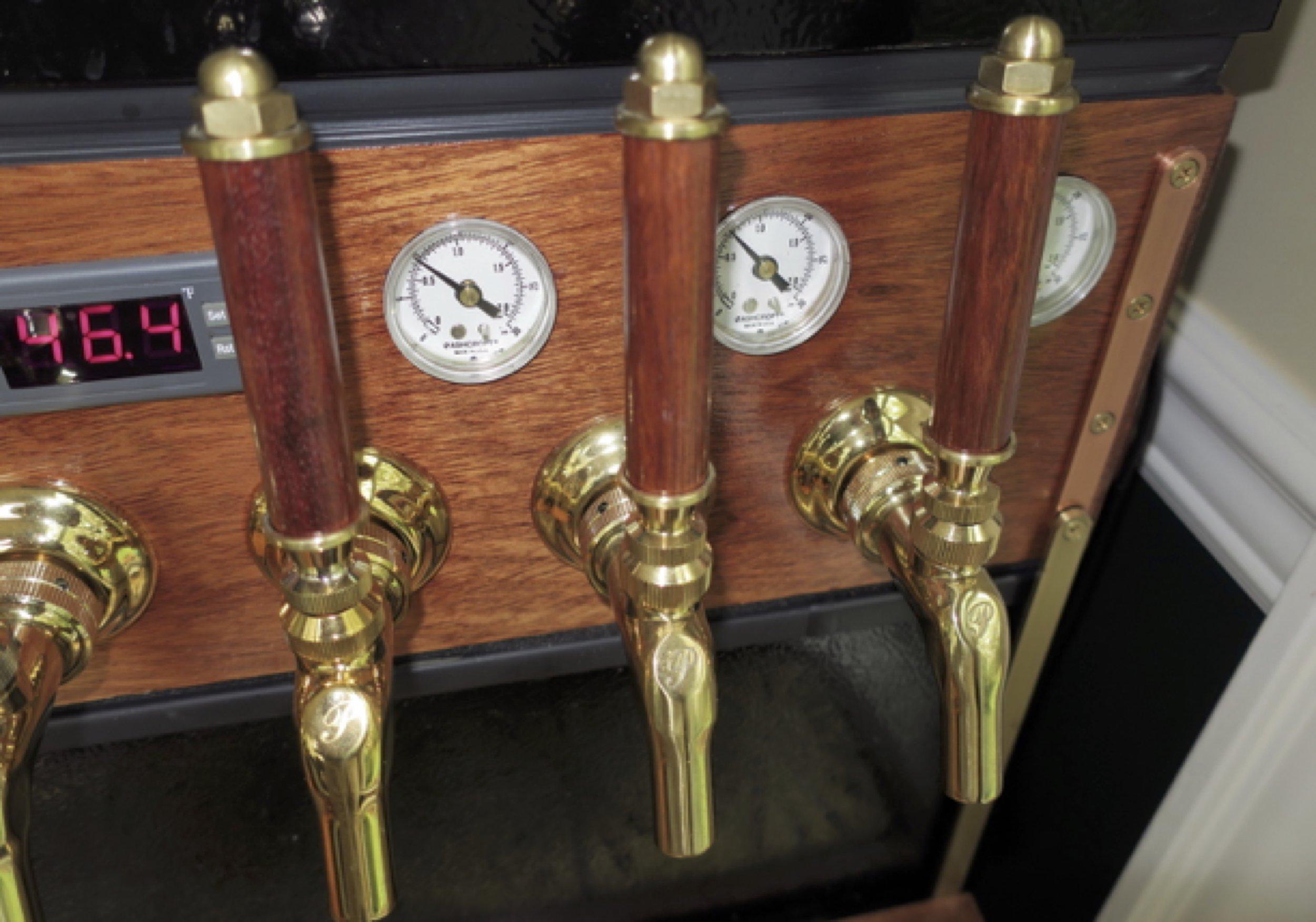 Pressure gauges on the tap for each keg.