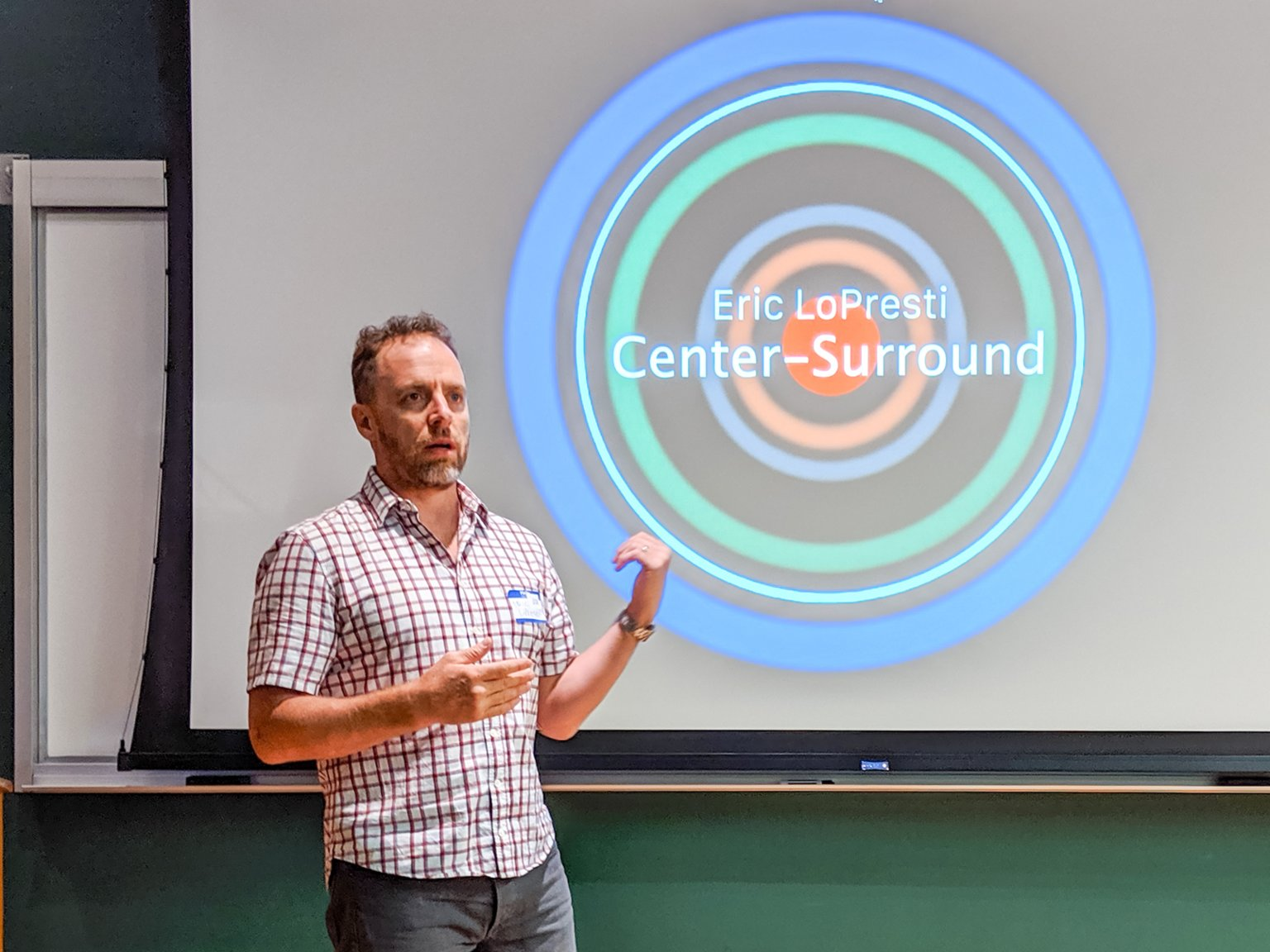 "LoPresti presenting his multi-channel video installation, ""Center-Surround"", at the Reinventing Civil Defense expo at the Stevens Institute of Technology. Courtesy Dave Mosher."
