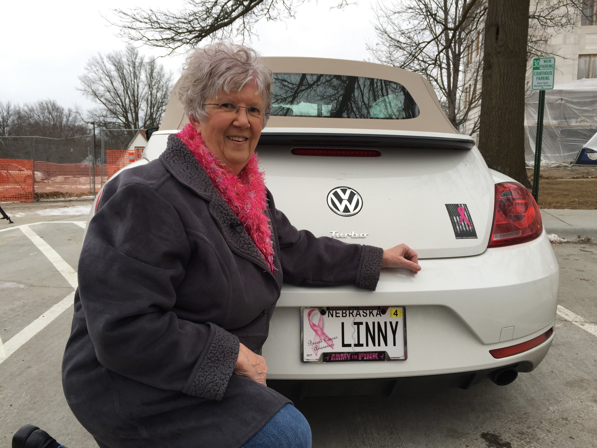 Linda Gill with new license plate.jpg