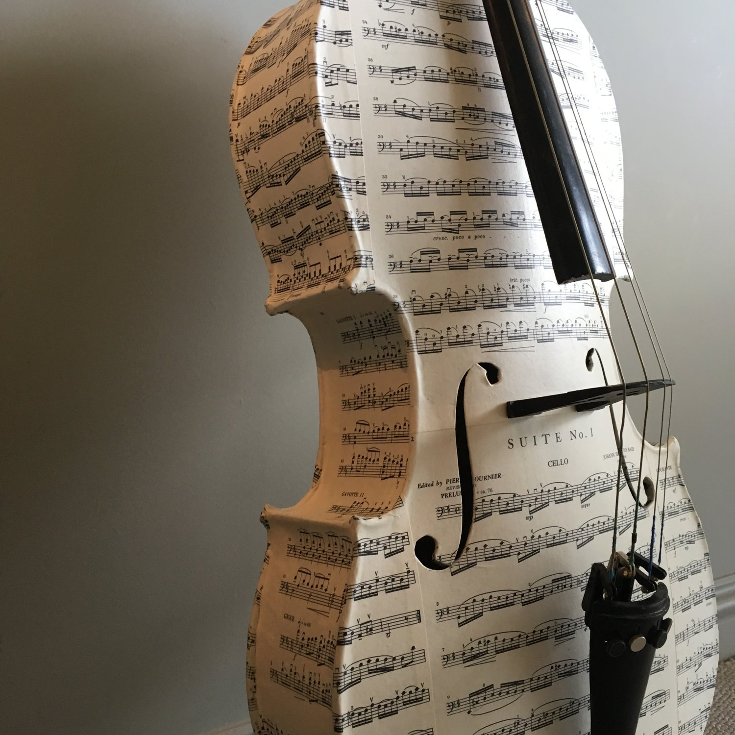 Vintage Bach Découpage Baby Cello - This Baby Cello becomes an art piece, reinvented via Découpage in pre-loved Bach sheet music. Coated in several layers dead flat varnish for durability.