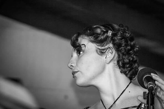 Here's another black and white photo of me looking at something with a microphone in my hand. 💕🍃💕 From Sofar's women's day show in Floripa 😻