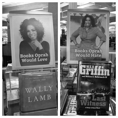 Two book tables at my local library. Some intern deserves a raise.