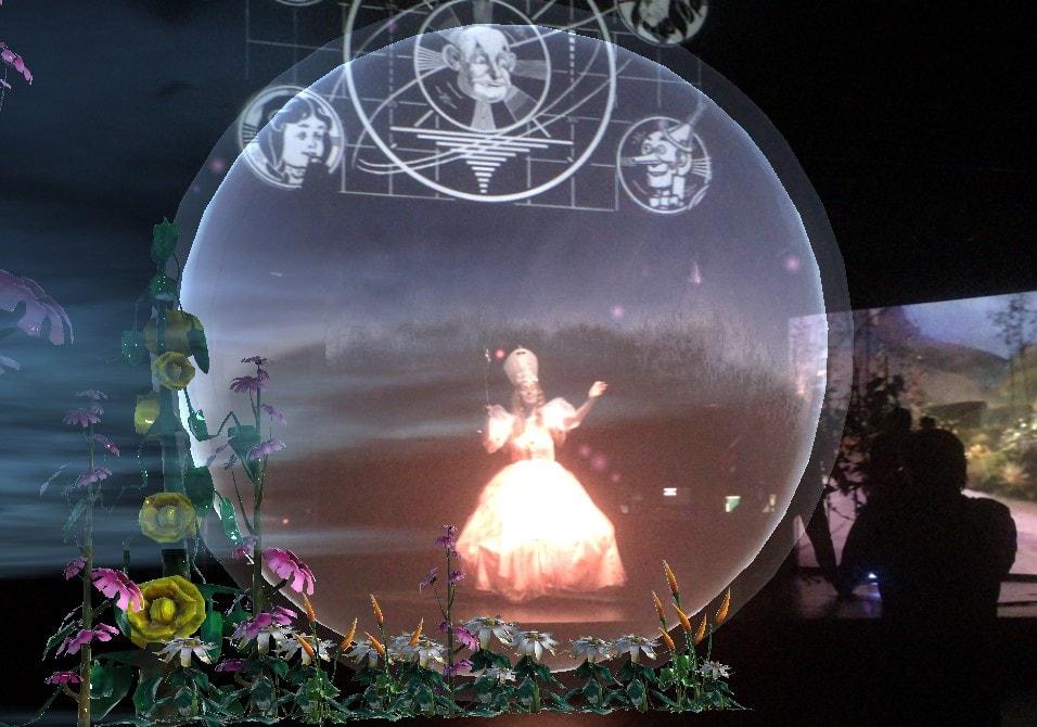 Moe Angelos as Glinda as seen through the interactive app.