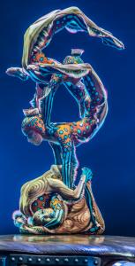 Imin Tysdendambaeva, Bayarma Zodboeva, Ayagma Tysbenova, Serchmaa Bayarsaikhan as eel-like contortionists. Top: Nico the Accordion Man (Nico Baixas), Mr. Mircrcosmos (Karl L'Ecuyer) and Klara (Ekaterina Pirogovskaya) provide some comic relief. Photos: Martin Girard / shootstudio.ca Costumes: Philippe Guillotel © 2014 Cirque du Soleil