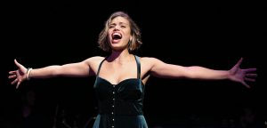 Renée sings a solo. Photographs by Carol Rosegg.