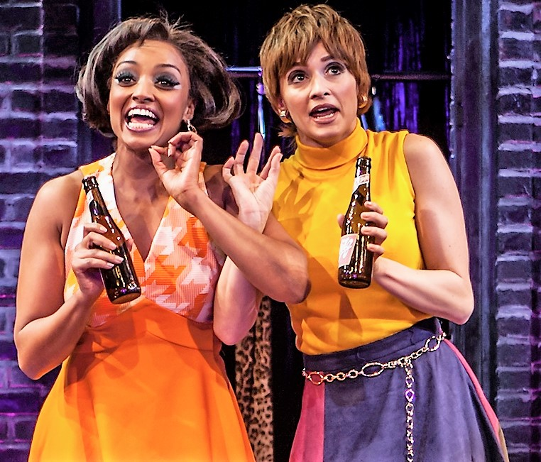 Asmerret Ghebremichael (left) as Nickie and Emily Padgett as Helene, Charity's sarcastic chums.