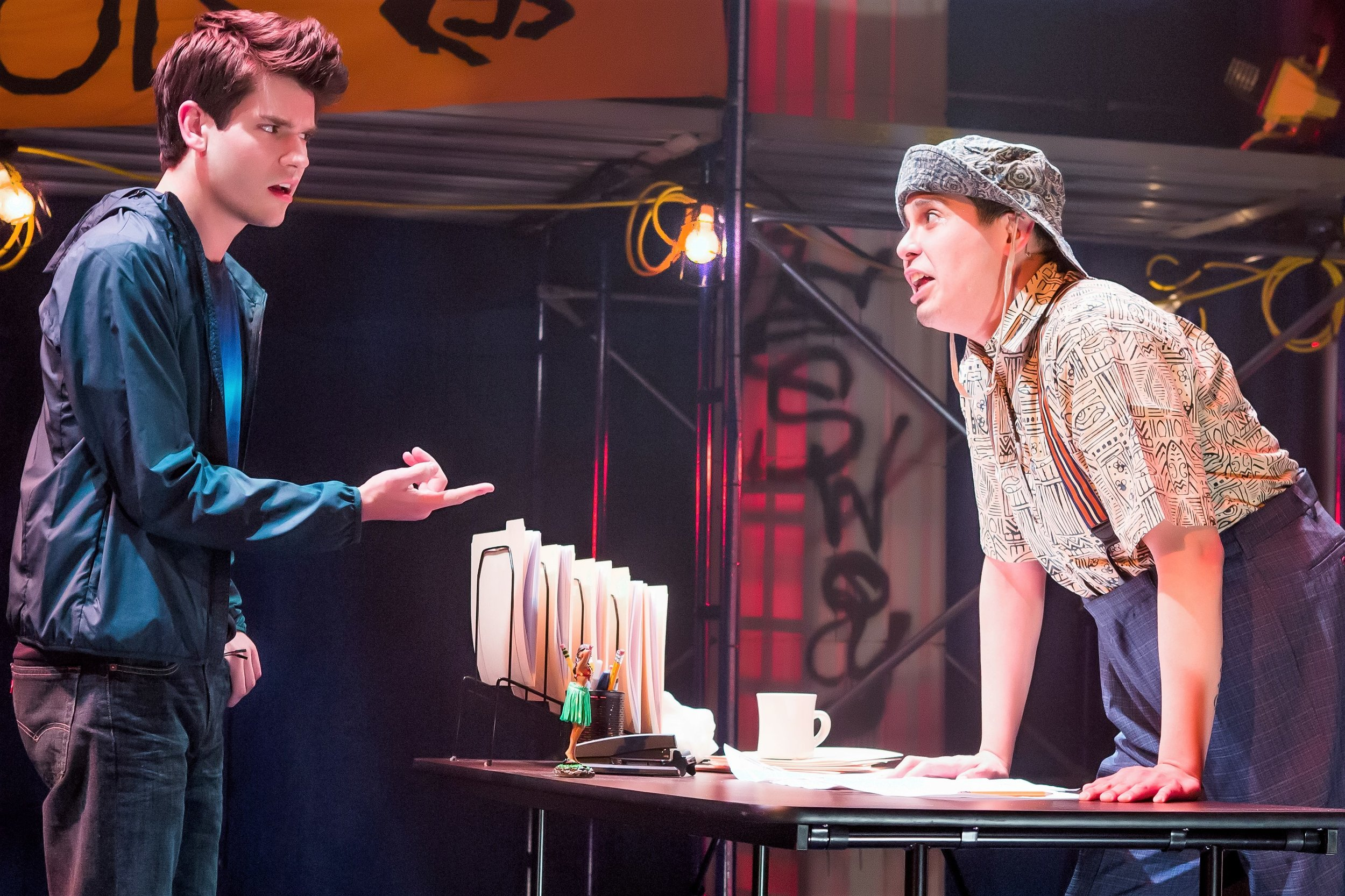 Percy (Chris McCarrell, left) gets a tongue-lashing from Mr. D (George Salazar) at Camp Half-Blood. Top: Percy meets the Oracle (Carrie Compere), but can she be trusted?
