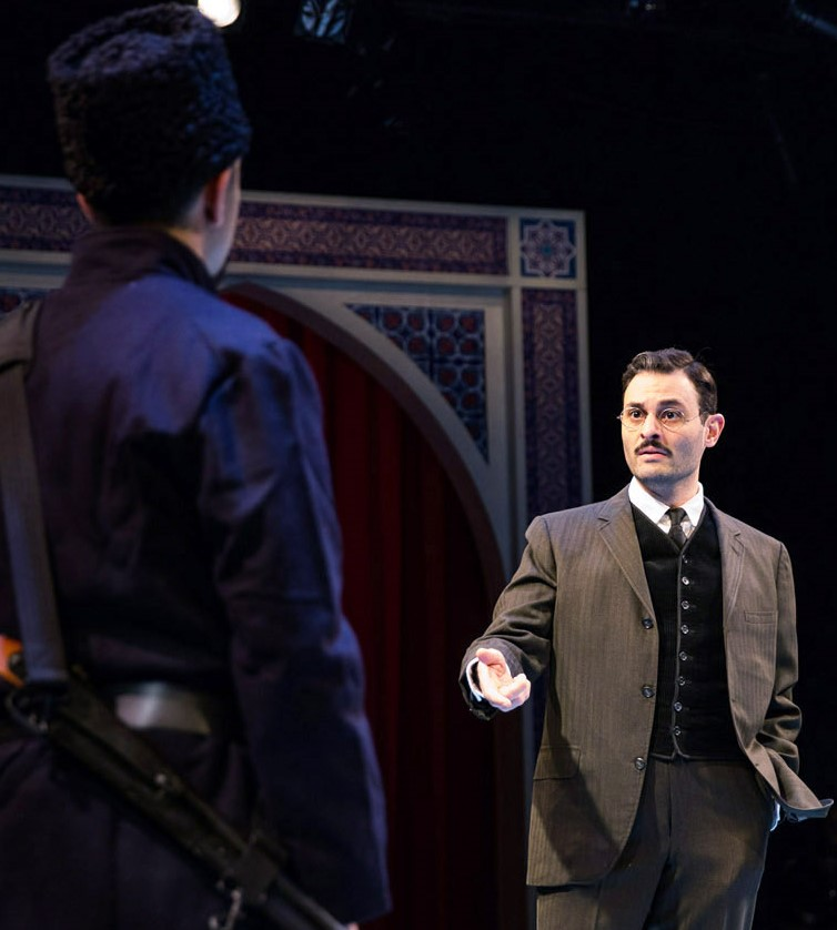 Arian Moayed (right) is Hamlet and Abraham Makany is Marcellus in Waterwell's production of Shakespeare's tragedy. Top: Hamlet with Yorick's skull.