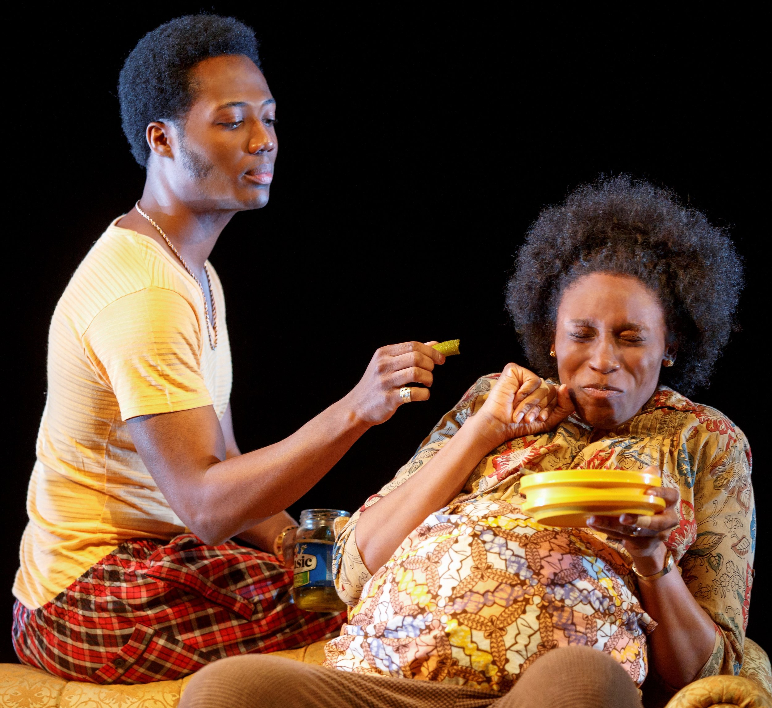 Ukpong (Hubert Point-Du Jour) and Ama (Chinasa Ogbuagu) in a playful moment in  Sojourners . Top: Prostitute Moxie (Lakisha Michelle May) and Disciple Ufot (Chinaza Uche) at Ama's bedside in  Sojourners .