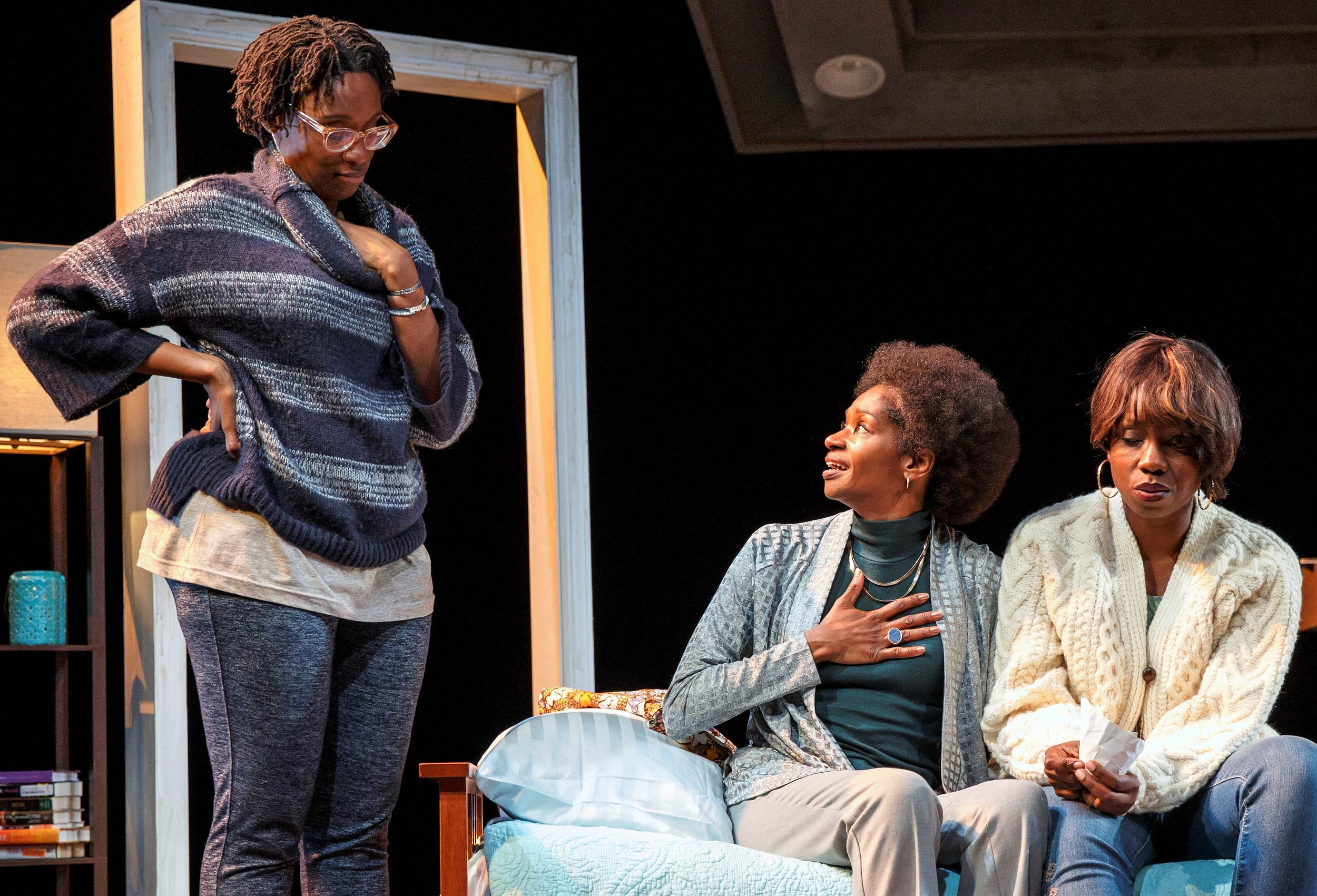 From left: Adiagha (Ogbuagu), Ama (Jenny Jules), and Iniabasi (Adepero Oduye) achieve a tenuous peace in  Her Portmanteau . Photos by Joan Marcus.