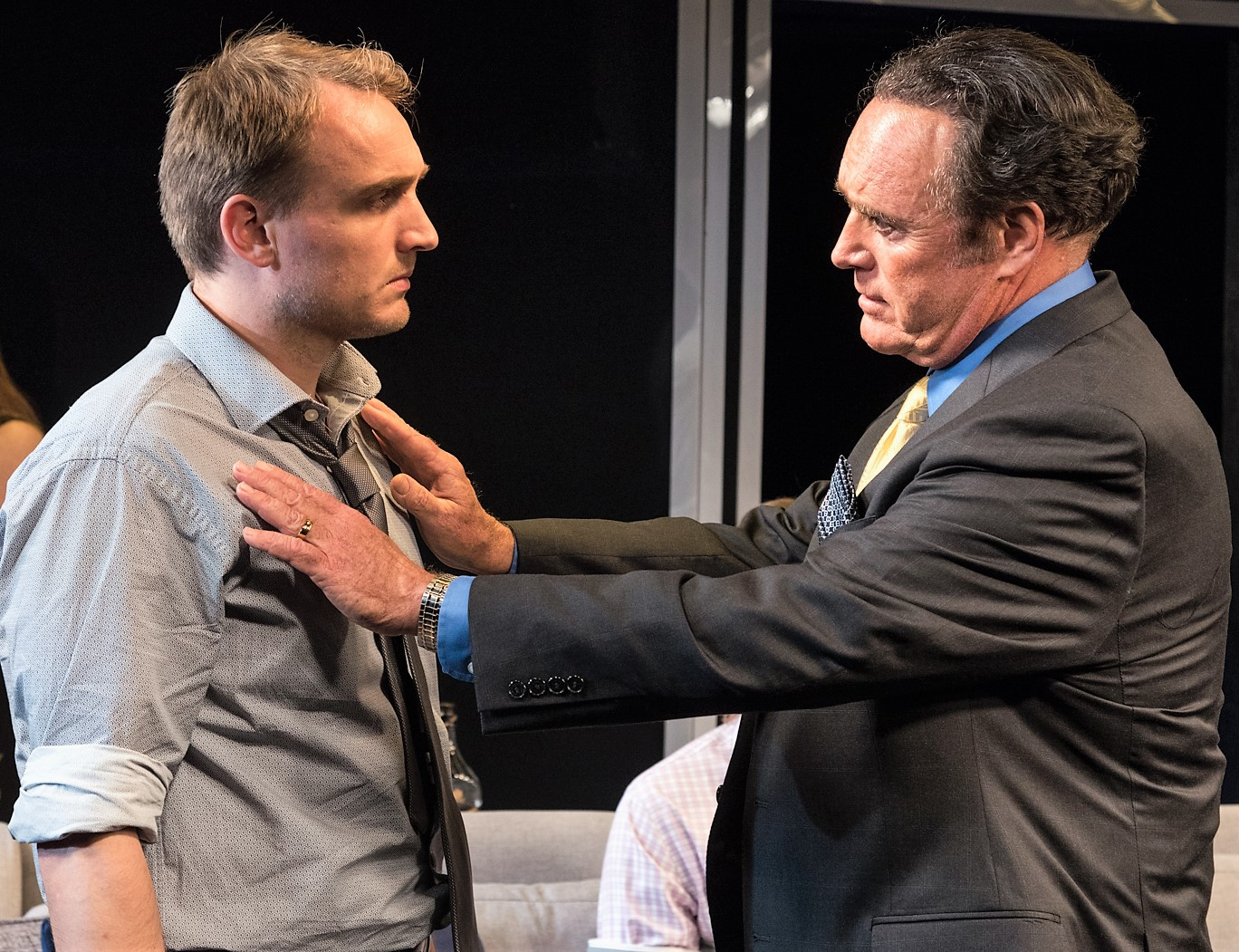 Big Jim (James Kiberd, right) tries to convince Jim Jr. (Ben Curtis) of his sins. Top, from left: Jim Jr. receives comfort from Grandma Viv'in (Kathleen Huber), Kimmy (Julie Campbell) and Bobby (Jacques Mitchell). Photographs by Russ Rowland.